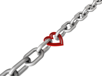 Image of links in a chain joined by a red metal heart