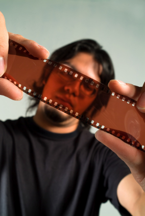 Man Examining Film Strip