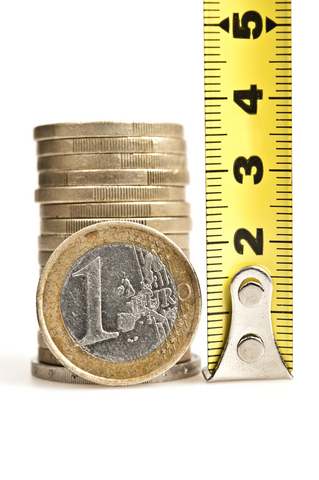 Stack of coins measured by measuring tape