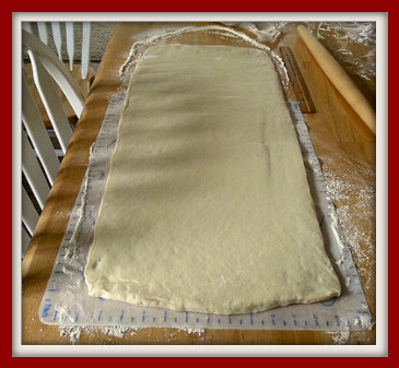 Dough rolled out on table